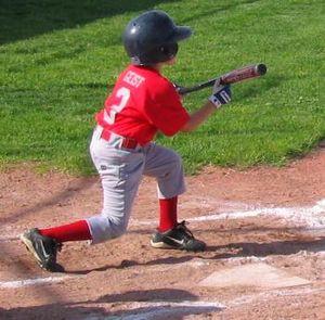 English: A Little League baseball player squar...
