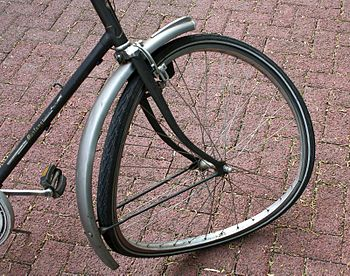 Torn front wheel of a bicycle after a crash wi...
